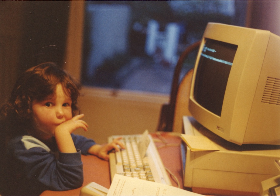 Jade Masterson Hally working on her computer, age 5